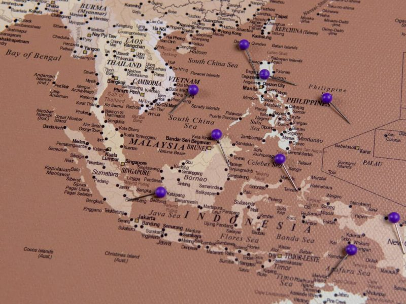 push pin world map with pins light brown