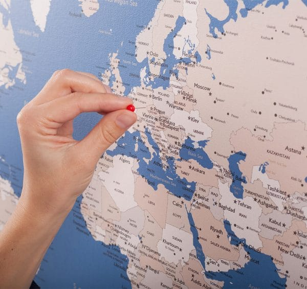 world map canvas with pins blue