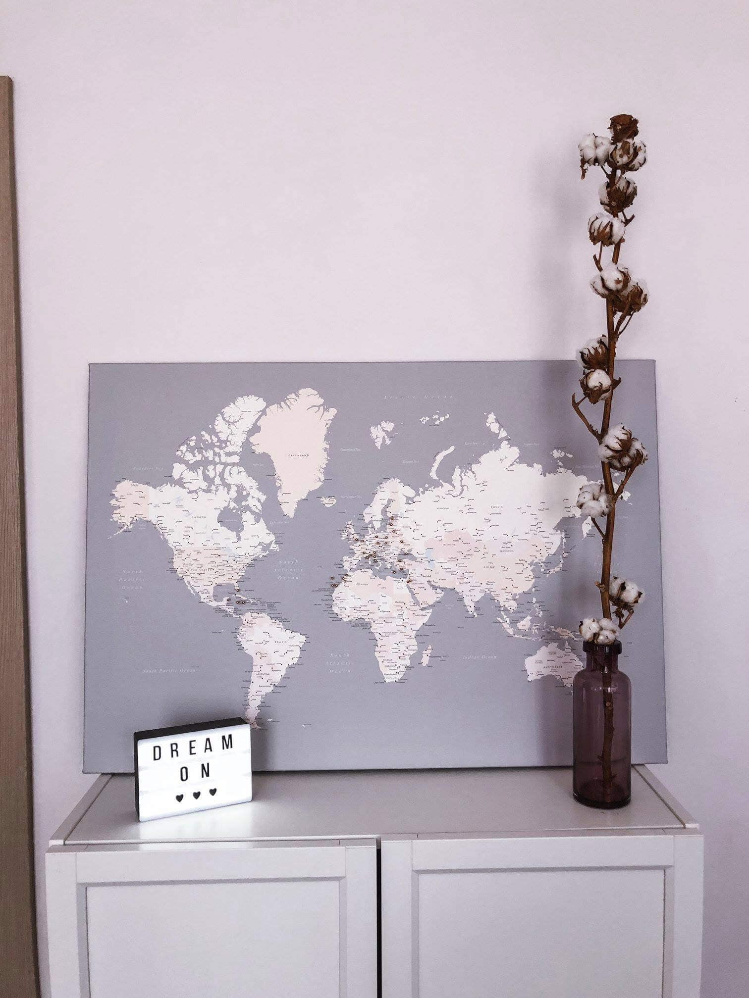 grey modern world map on canvas with push pins