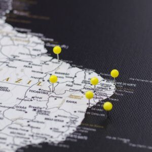 pinned yellow colour pins on canvas map