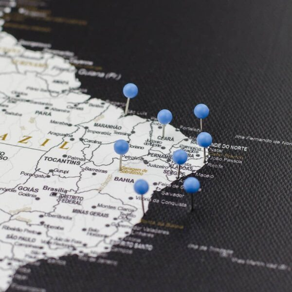 light blue colour pin on canvas map pinned
