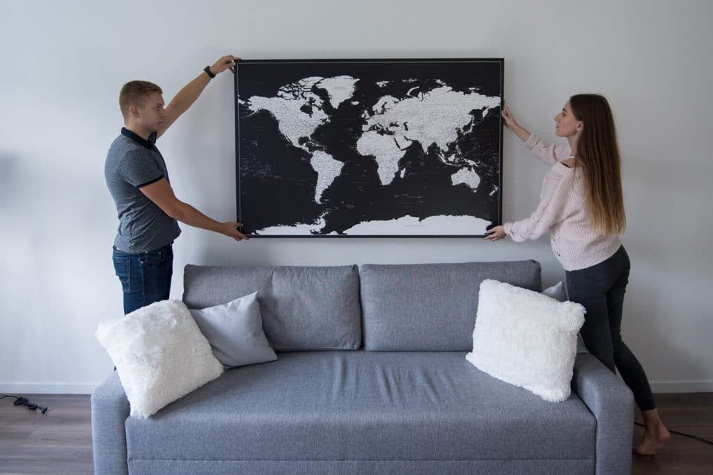 large black and white world map with pins