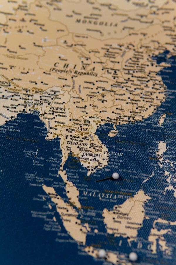 asian islands in the world map pinboard with pins