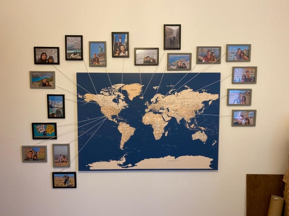 blue world map with pins and string